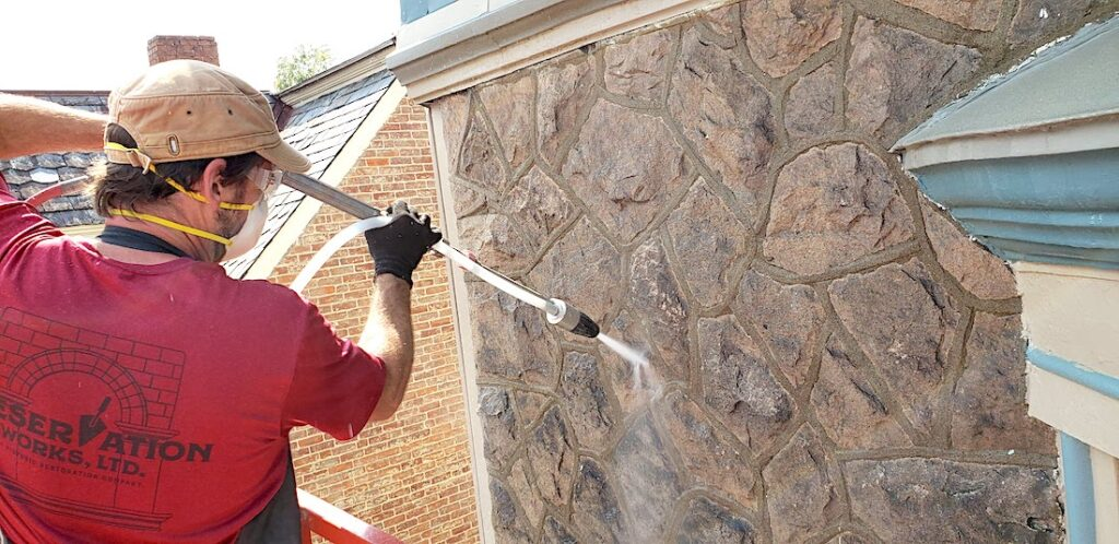 Rob Wozniak uses the Thermatech to delicately clean historic stone surfaces